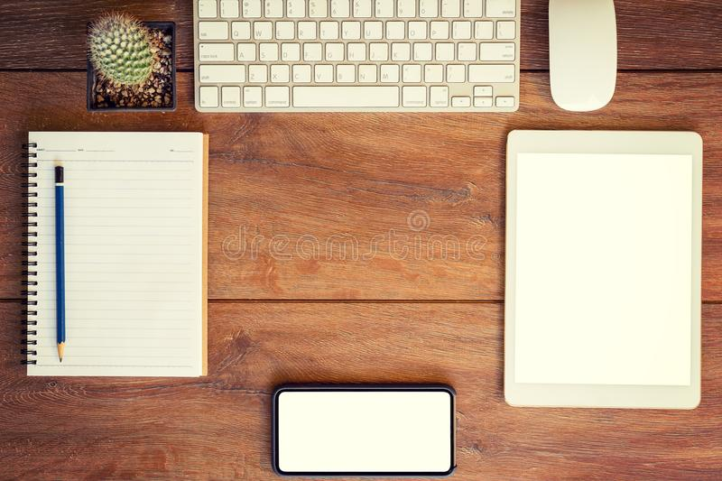 Working place. desktop, notebook, phone and tablet for table set. Ting stock photos