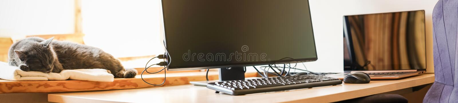 Working place with IT equipment at home. Flexible hours and remote working concept. Panorama. Working place with IT equipment at home is used as homebase office stock photo