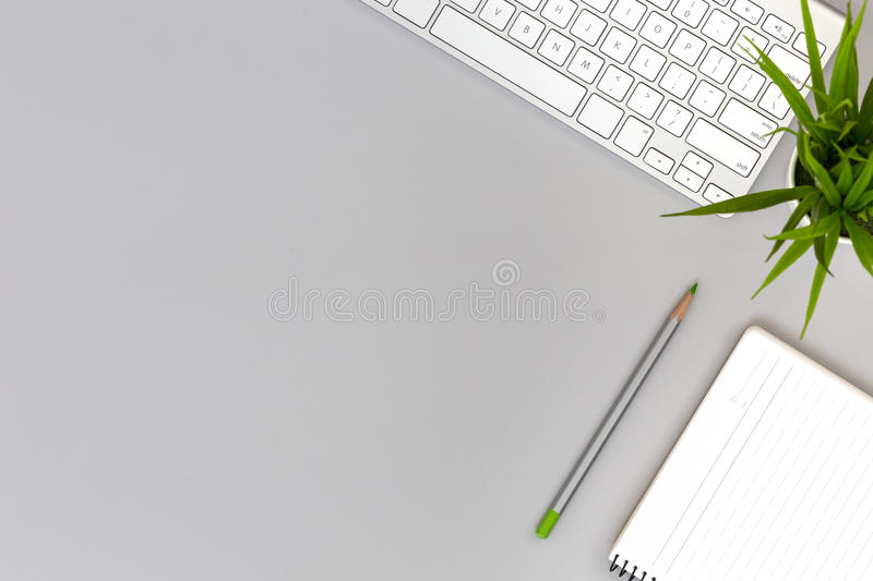 Working Place on grey Table with Business and Lifestyle Items stock photo