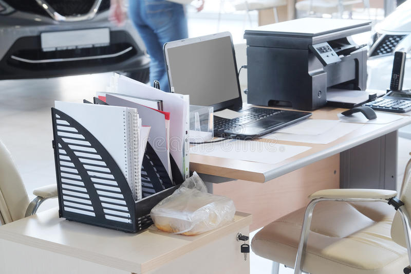 Working place of managers in a dealer's car showroom. Serpuhov, Russia, June, 2015: Working place of managers in a dealer's car showroom in Serpuhov, Russia stock photography