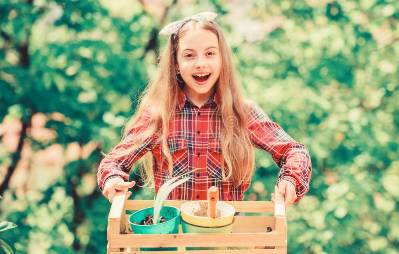 Working with plants. summer farm. Happy childhood. spring village country. ecology environment. Happy childrens day. Little girl with gardening tools. earth royalty free stock photo