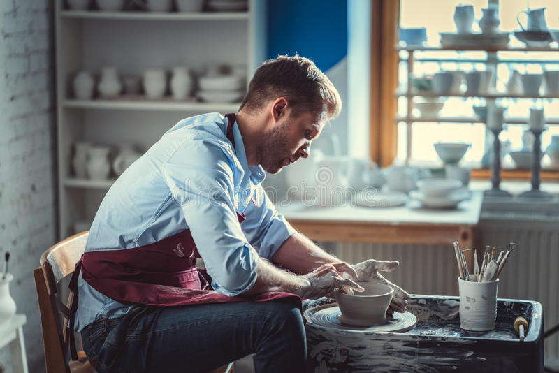 Working potter royalty free stock image