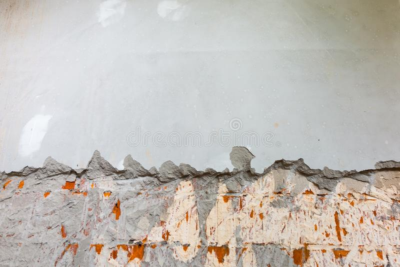 Working process of dismantling blonding plaster on the wall before of installing metal frames for plasterboard -drywa. Ll - for making gypsum walls in apartment royalty free stock photography