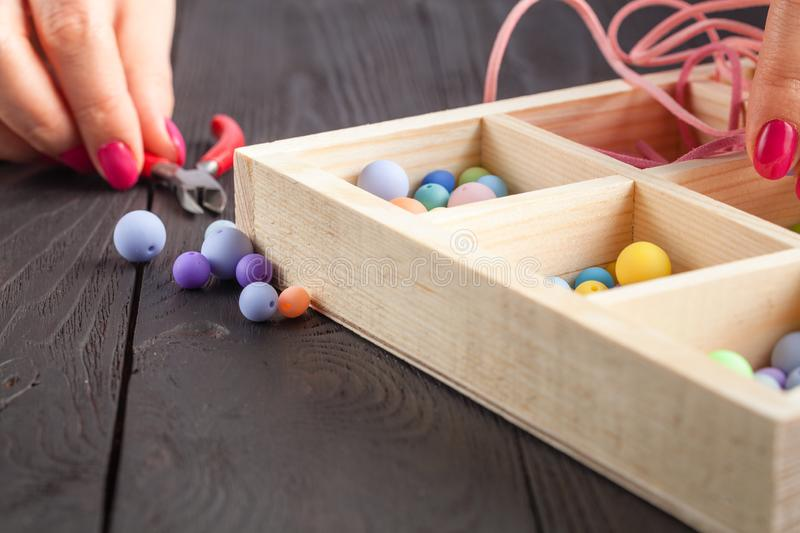 Working process. Handcraft concept. Creative woman making beautiful beads of colorful balls stock photos