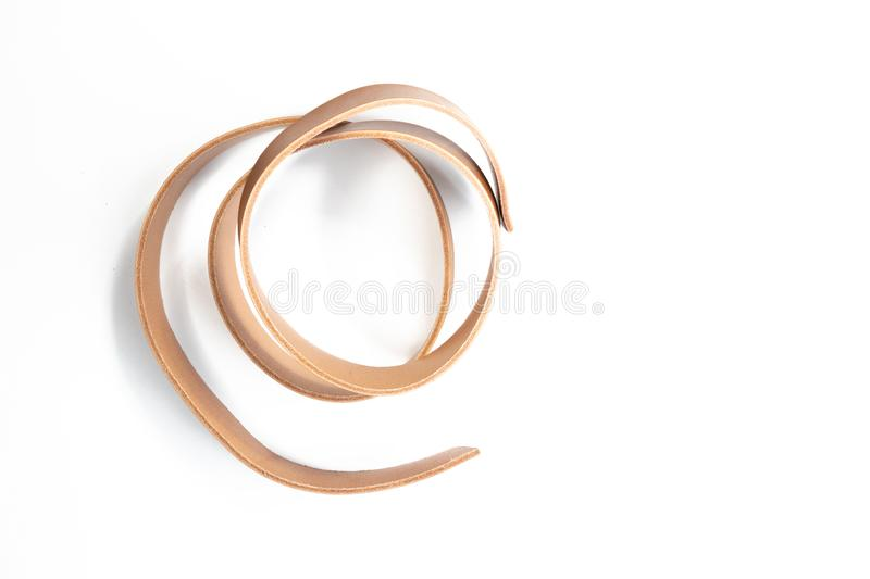 Working process of the leather belt on white. Background royalty free stock images