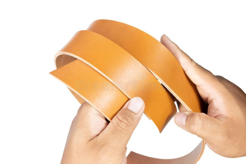 Working process of the leather belt on white. Background stock images