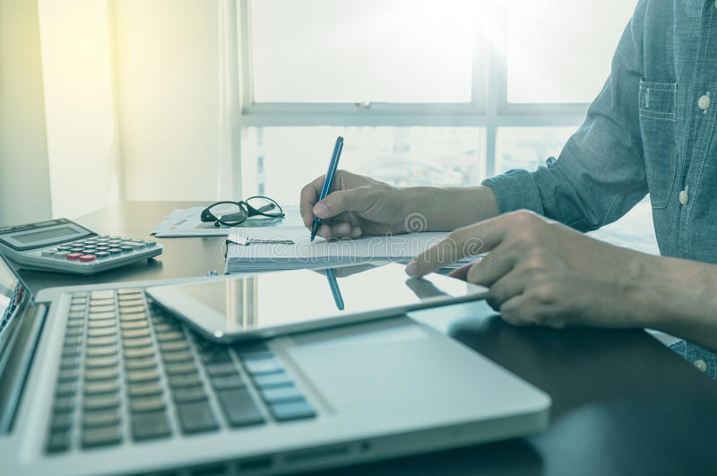 Working process, Man writing on note paper with color pen. Business, office concept. Working process, Man writing on note paper with color pen stock image
