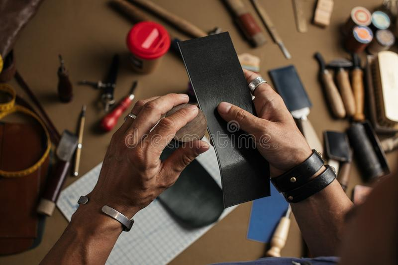 Working process of producing hand made leather wallet in the leather workshop. Working process of hand made leather wallet production in the leather workshop stock photography