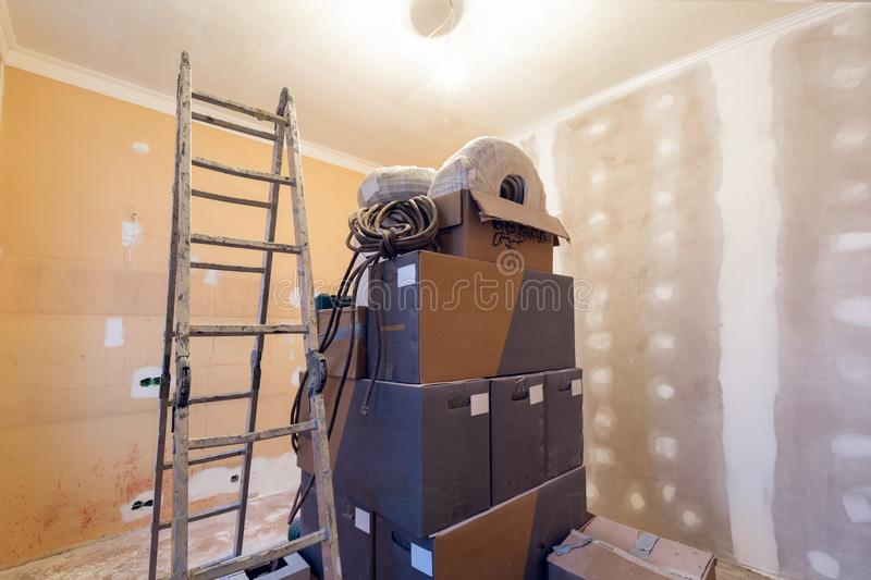 Working process of renovate room with installing drywall or gypsum plasterboard and ladder with construction materials royalty free stock images