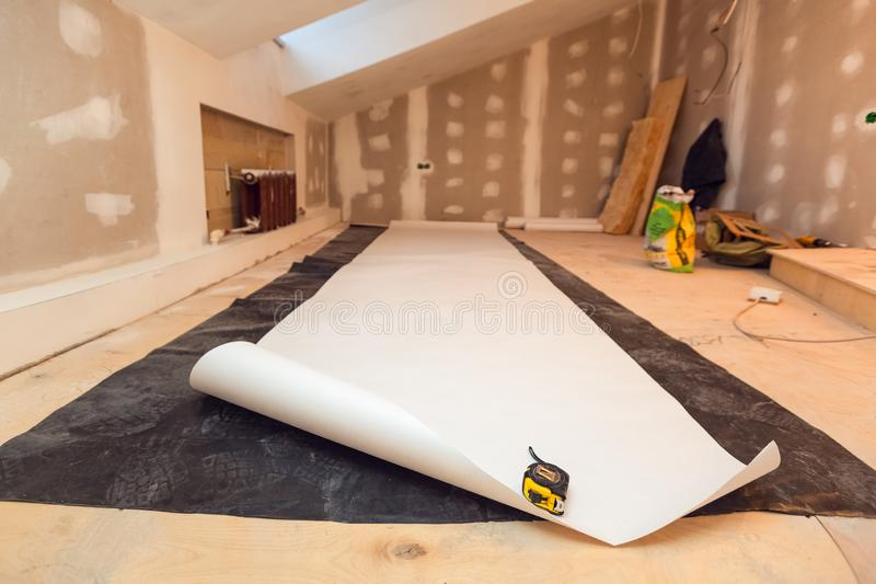 Working process of wallpapering on the drywall in small room apartment is under construction, remodeling, renovation. Extension, restoration and reconstruction royalty free stock image