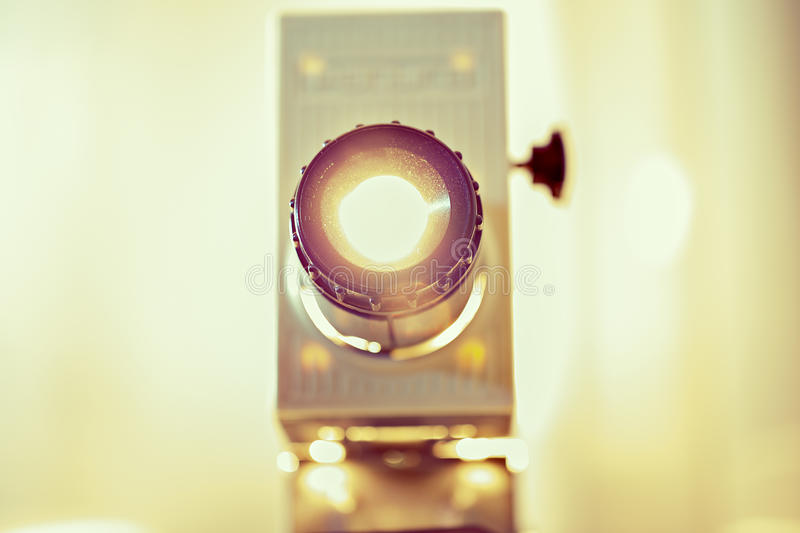 Working projetor is lightened up by camera stock photo