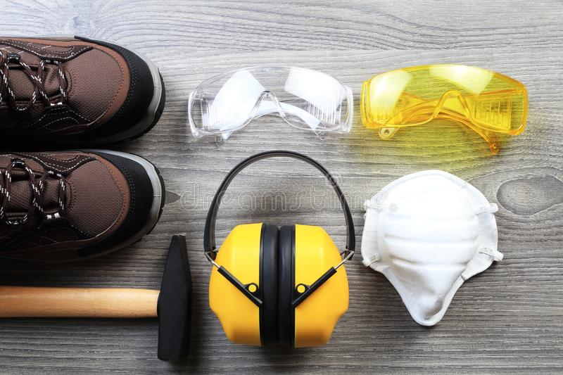 Working protective wear and accessories. New constructor glasses and headphones from above. Working devices from above stock images