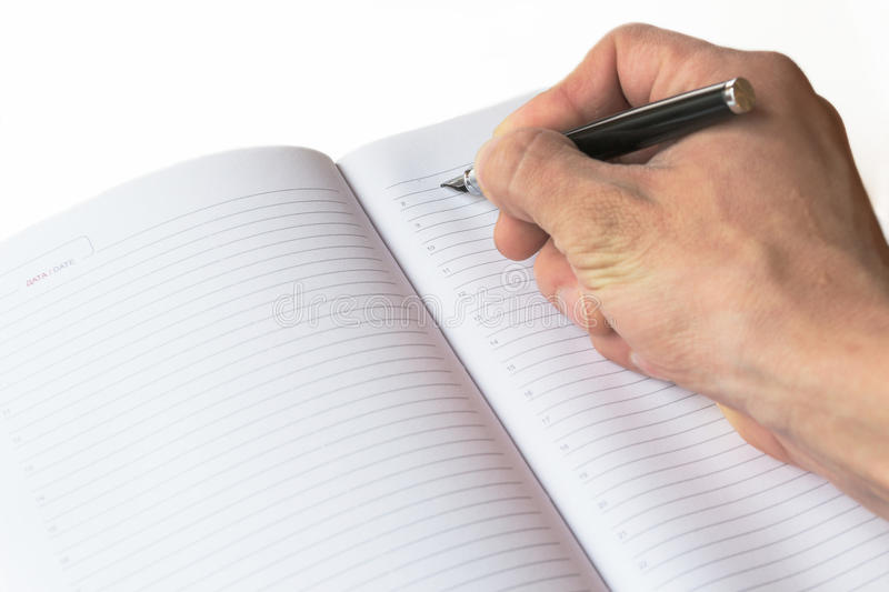 The recording of the fountain pen in Notepad royalty free stock photography