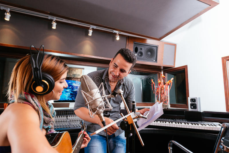 Working in the recording studio stock images