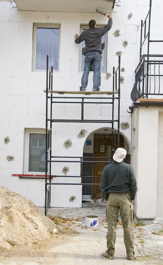 Working on scaffolding stock photos