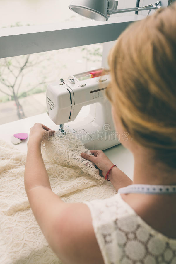 Working on sewing machine royalty free stock photos