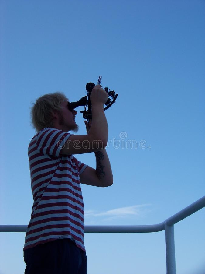 Working with sextant on board of merchant vessel at noon time royalty free stock image