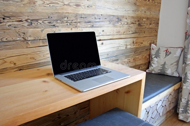 Work while on vacation. Working while on a skiing vacation in an Austian Hotel royalty free stock images