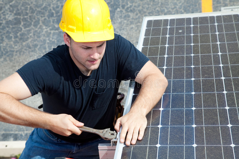 Working on Solar Panel royalty free stock images