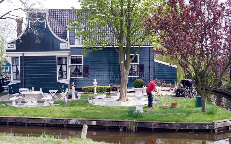 Working in spring garden. Working man in Zaanse Schans ethnographic museum in Netherlands royalty free stock photos