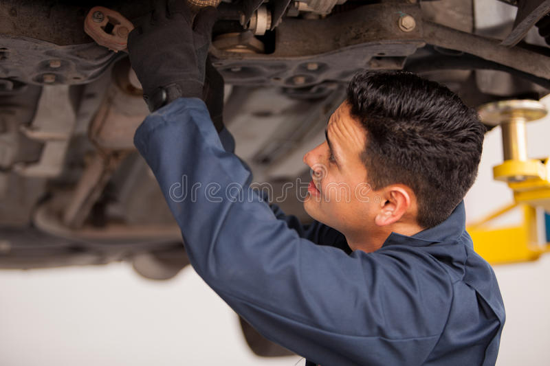Download Working On A Suspended Vehicle Stock Photo - Image of lift, repairing: 33750044