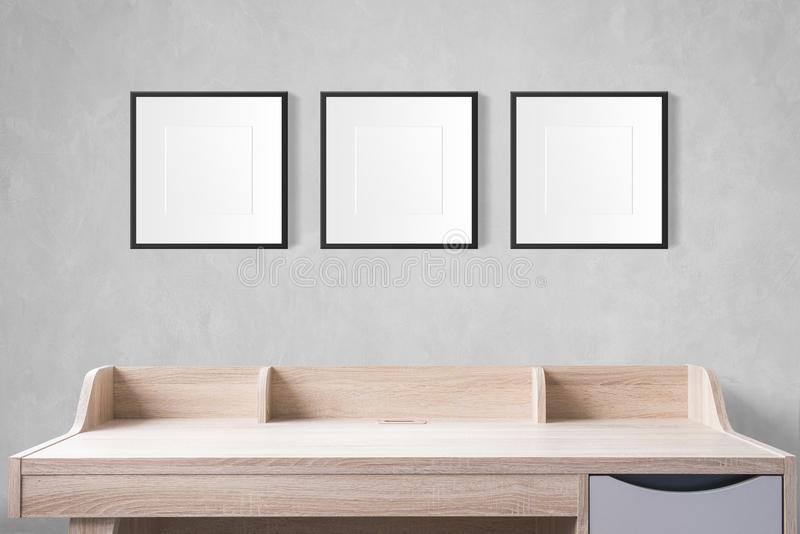 Working table with blank photo frames in the empty studio with c stock photography
