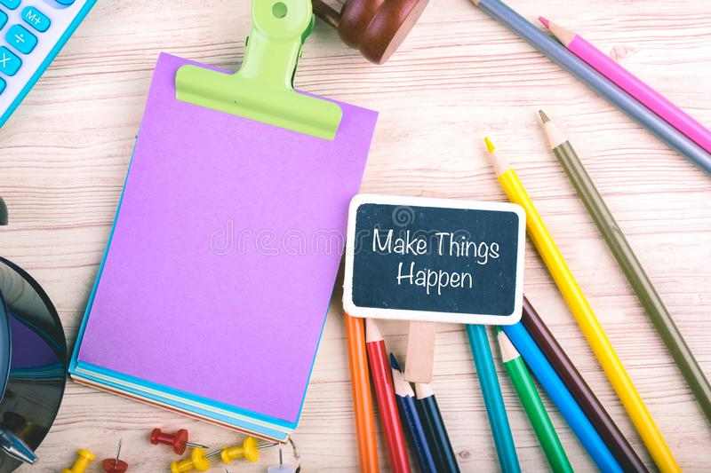 Calculator, pencils, thumbtacks and Make Things Happen word written on notepad stock images