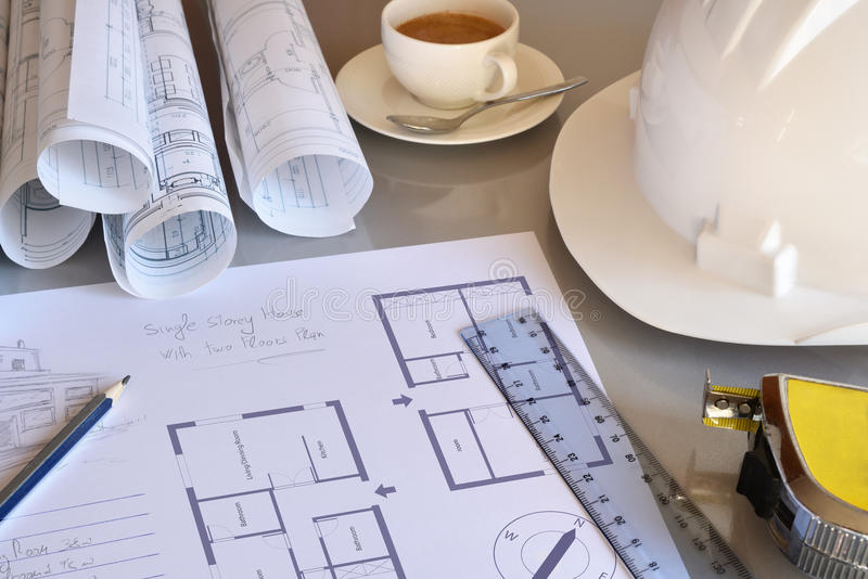 Working table of construction engineer with plan of project closeup royalty free stock photo