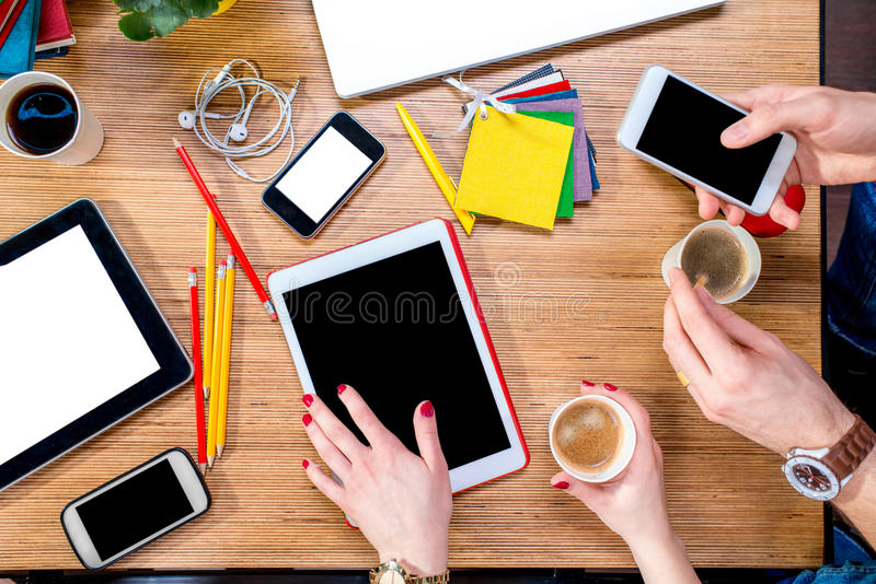 Working on table with gadgets royalty free stock images