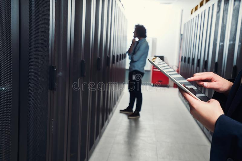Working on tablet. server room stock image