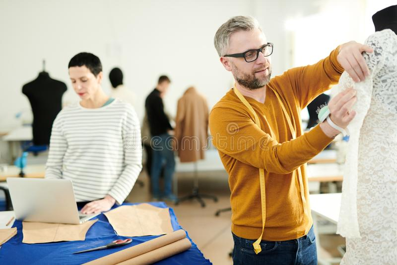 Working in tailoring shop royalty free stock image