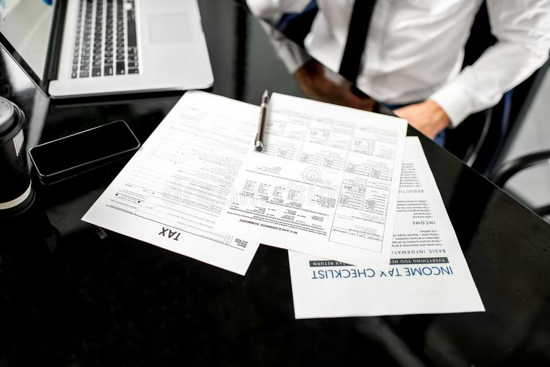 Working with tax documents stock images