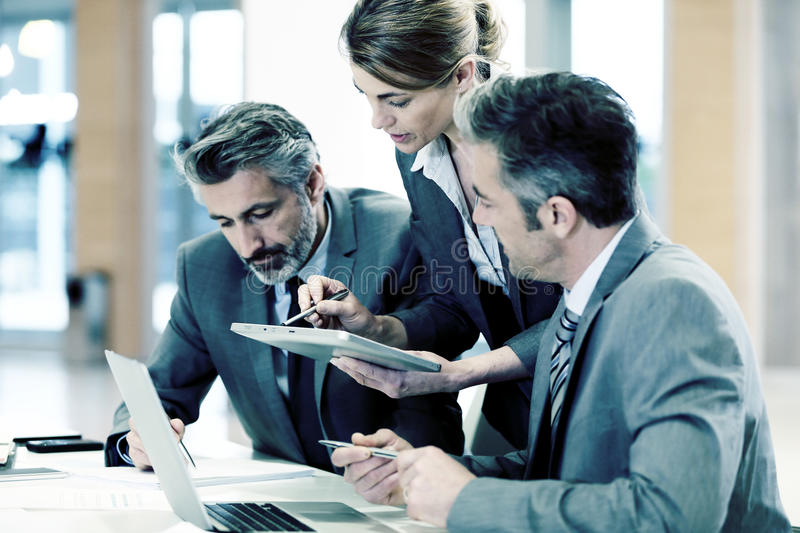 Working team of business partners stock photo