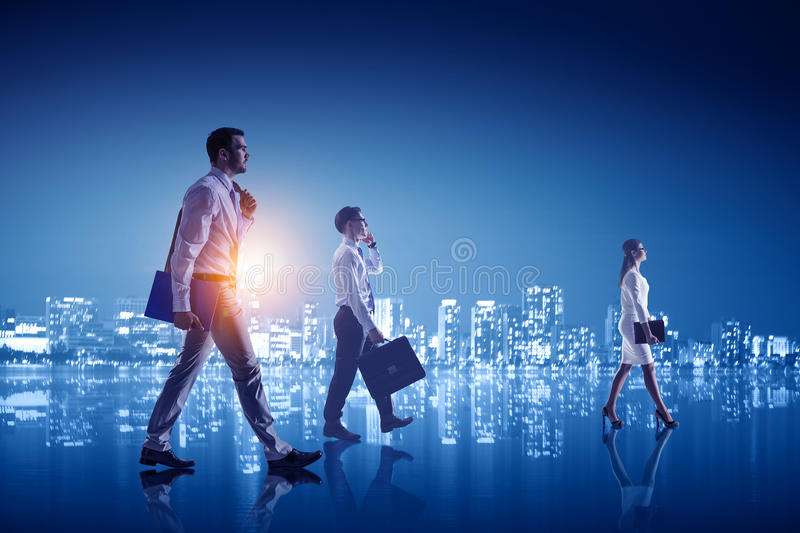 Working till late night . Mixed media. Group of business people against night city background stock images