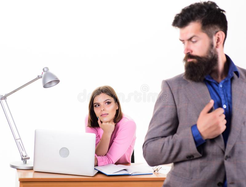 Working together. Manager boss stand in front of girl busy with laptop. Office manager or secretary. Sexy lady office stock photography