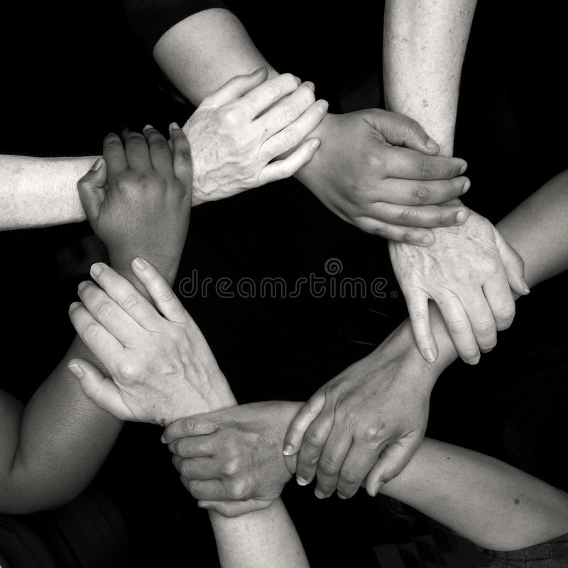 Diversity women`s empowerment hands of color. Working together women of different backgrounds create hand mandalas. diversity wins! created after the women`s stock photo