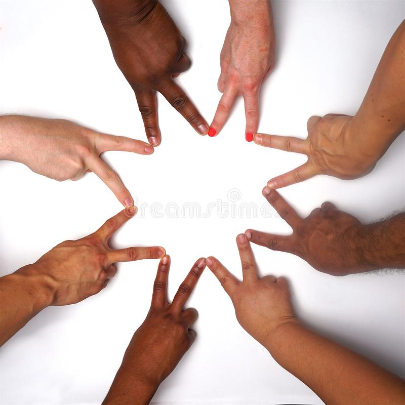 Diversity women`s empowerment hands of color. Working together women of different backgrounds create hand mandalas. diversity wins! created after the women`s royalty free stock photos