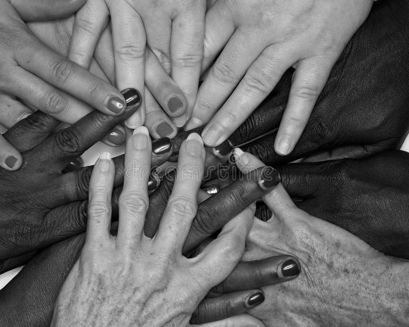 Diversity women`s empowerment hands of color. Working together women of different backgrounds create hand mandalas. diversity wins! created after the women`s stock image