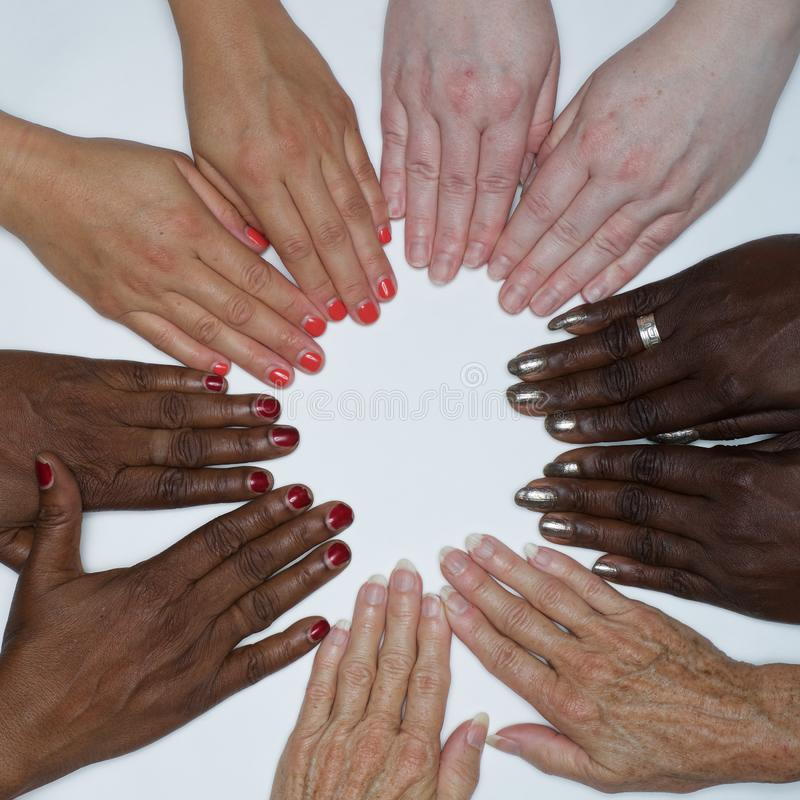 Diversity women`s empowerment hands of color. Working together women of different backgrounds create hand mandalas. diversity wins! created after the women`s royalty free stock images