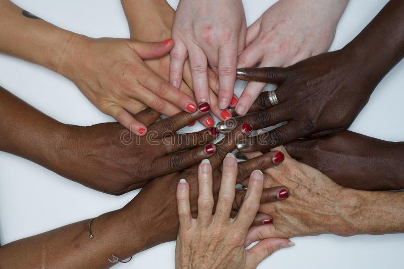 Diversity women`s empowerment hands of color. Working together women of different backgrounds create hand mandalas. diversity wins! created after the women`s royalty free stock image