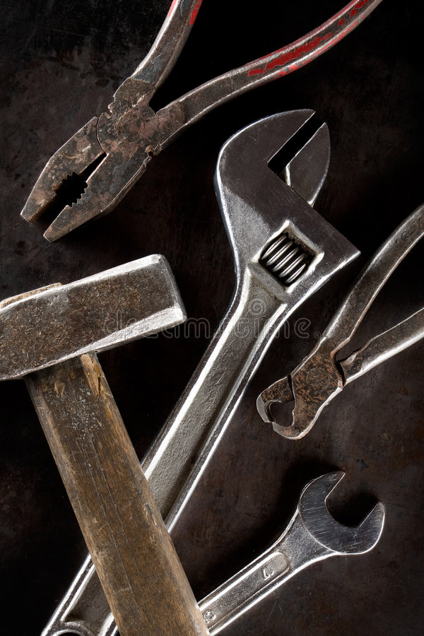 Working tools. On a grunge background stock photography