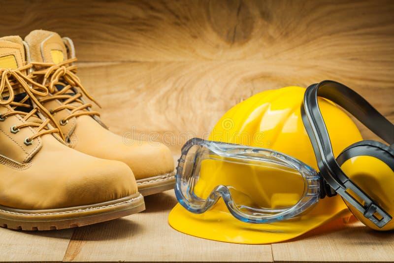 Working tools. construction concept. yellow construction helmet earphones working boots stock images