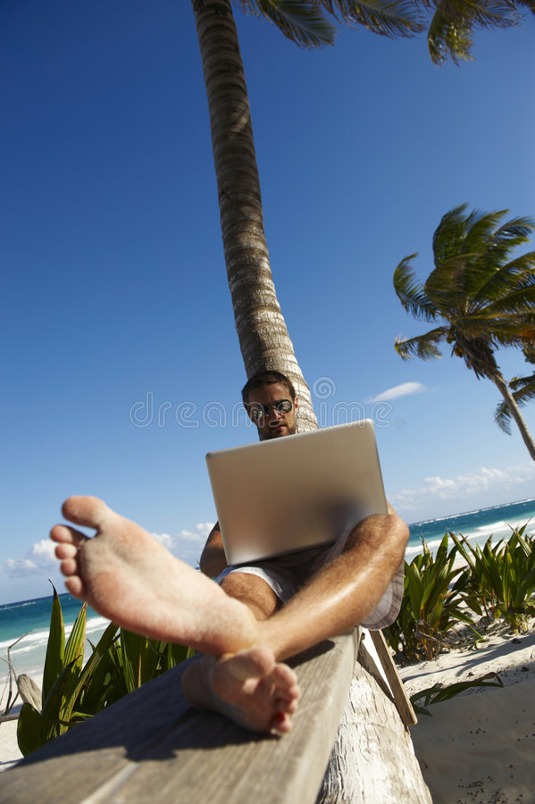 Working on vacation royalty free stock photography