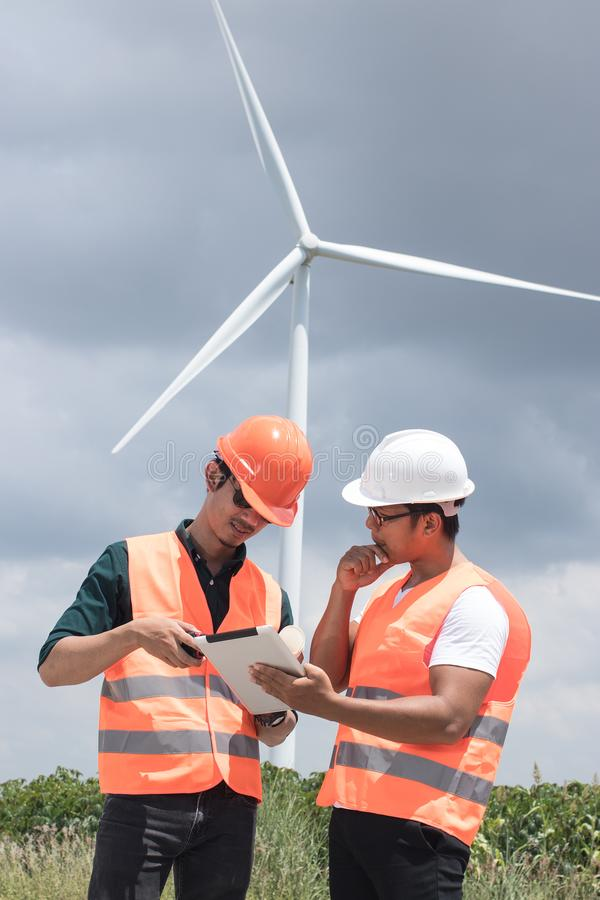 Working at the wind turbine. stock photos