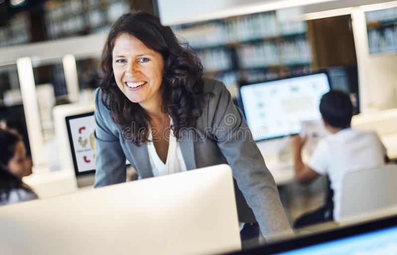 Working Woman Smiling Standing Concept stock photos
