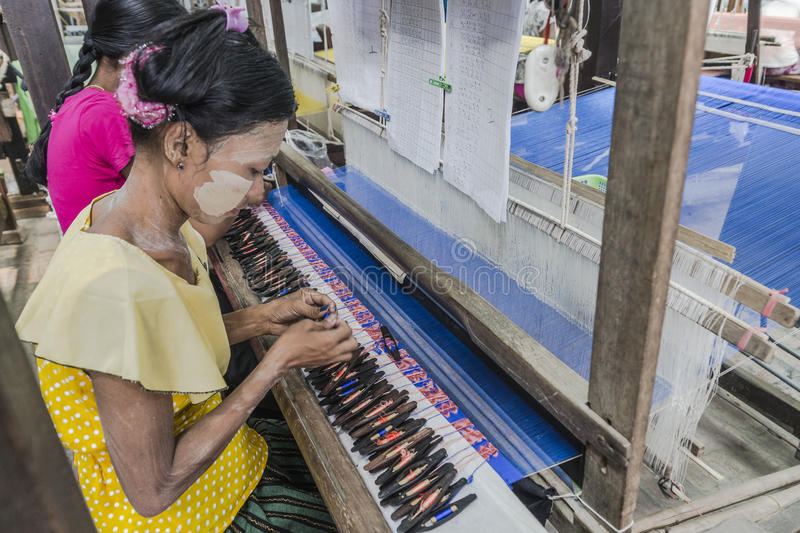 Working woman by weaving royalty free stock image