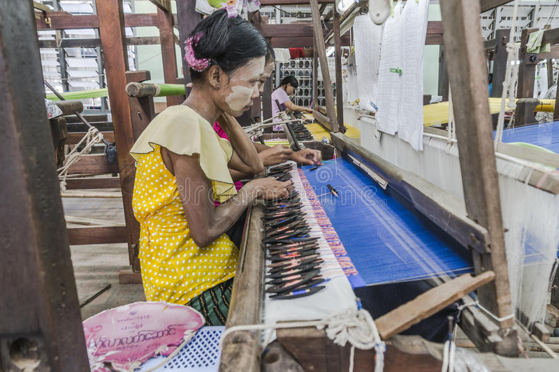 Working woman by weaving stock image
