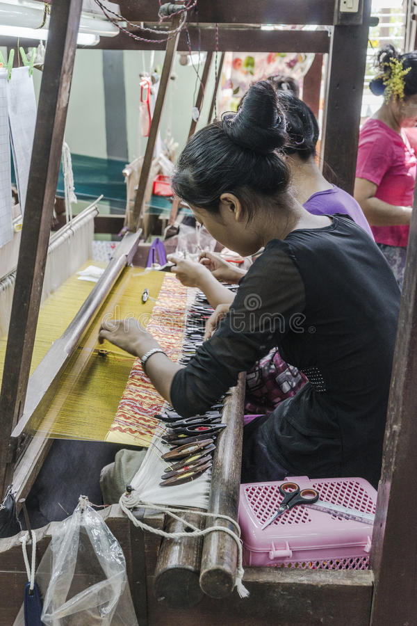 Working woman by weaving stock photo