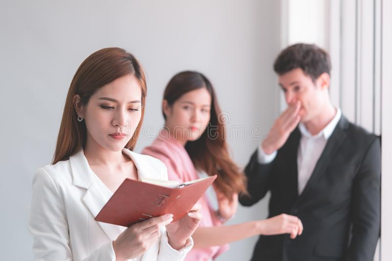 Working woman taking gossip from co worker stock photography