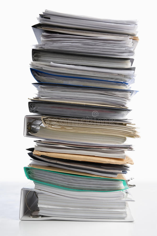Workload. Pile of paper on white background. Workload concept stock photo